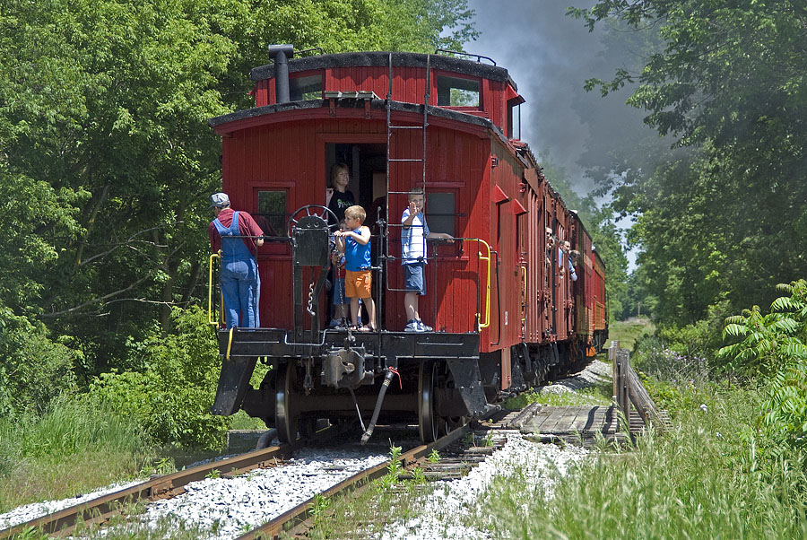 Passengers enjoy the view from the caboose on a weekend LRR excursion. (May, 2007)