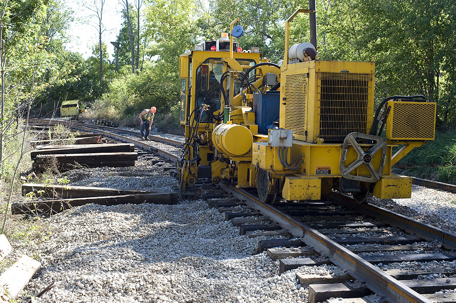 New ties are inserted under newly installed rail in the curve at Steubenville, Indiana. 2 of 3 photos. (September, 2009)