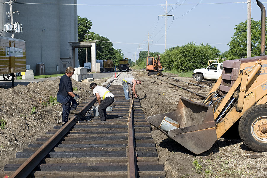 IN track crews refurbishing spur to Star Of The West Milling. (June, 2009)