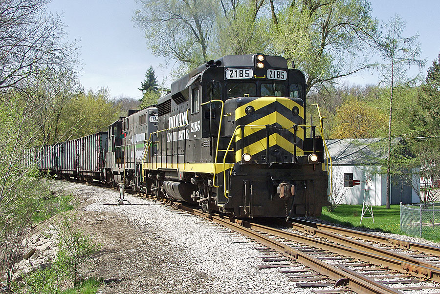 IN 2185 leads a coal train arriving Hillsdale, passing over the east-leg wye switch. (April, 2003)