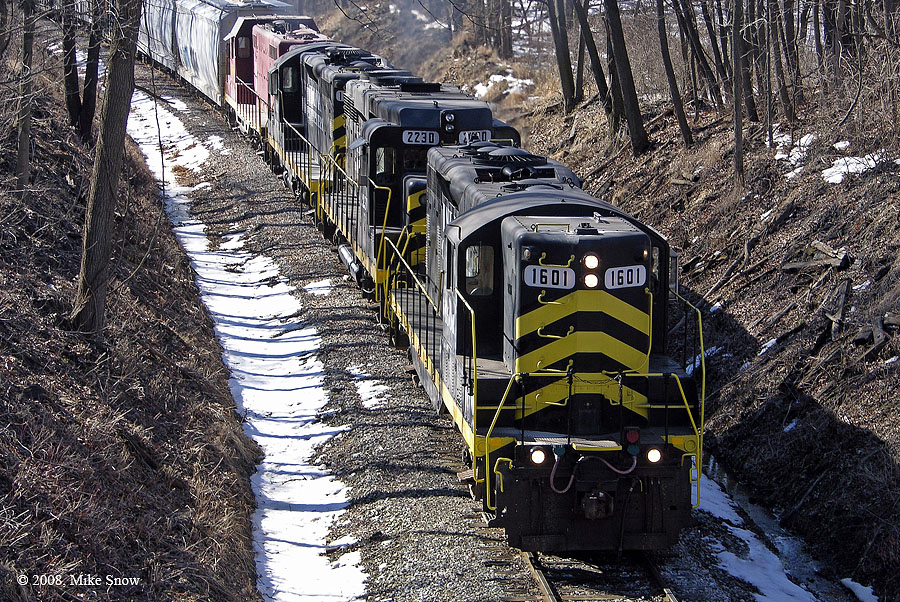 IN 1601 is northbound leading a train under the Fox Lake Road overpass in Angola. (March, 2007)