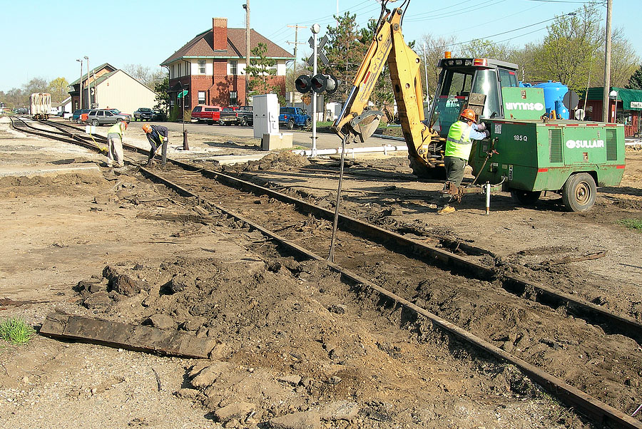 Crews replace the grade crossing at Hillsdale Street in Hillsdale as part of a city sewer project. (April, 2006)