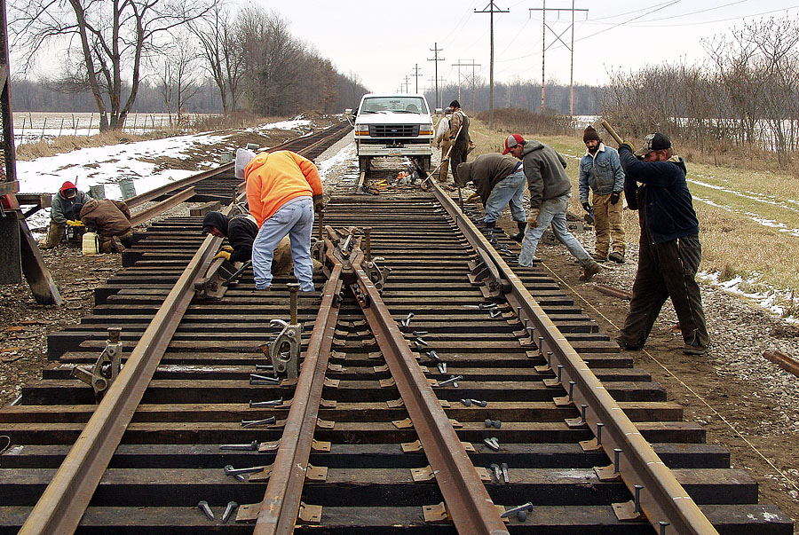 Track contractor installs a new passing siding in Litchfield to help better serve the M.S.C.P.A. power plant with coal. (December, 2003)