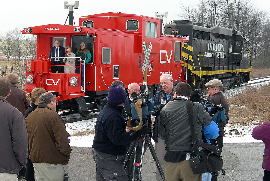 Michigan Congressman Joe Schwarz talks to the media while on a caboose tour of the railroad. (January, 2006)